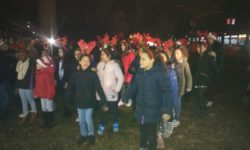 The P.S. 190 Glee Club warms up those on hand with some Christmas songs.