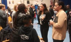 After the meeting AOC listened to a concerned parent and others.