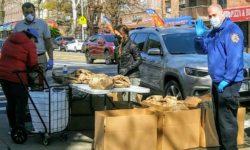 Senator Biaggi handing out the three hundred meals.