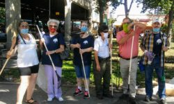 Bronx Parks Commissioner Iris Rodriguez is joined by some of her Parks Department employees, and a few of the volunteers.
