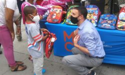 11th City Council candidate and 81st A.D. Male District Leader Eric Dinowitz handed the book bags to the children.