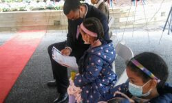 Senator Bailey going over the program with one of his daughters.