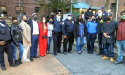 A group photo with Police Commissioner Shea, City Council members Gibson and Salamanca, and others who were involved in setting up the event.