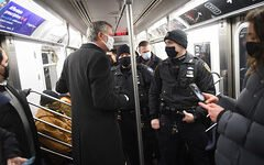 Mayor de Blasio rides a subway on the day Governor Cuomo announces less hours of subway closure